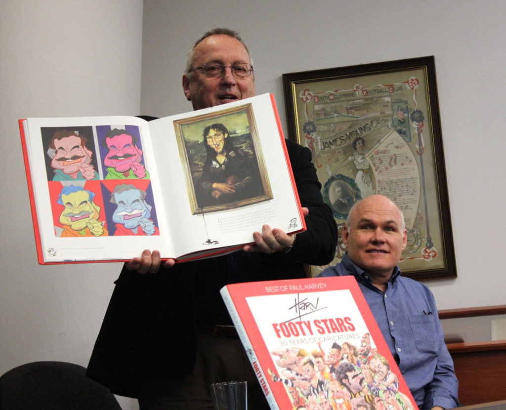 Cartoonist John Spooner was at the MCG Library on July 3rd to help launch Paul Harvey's new book